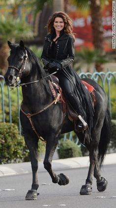 Shania Twain. Not one of my favorite musicians but hey, she's on a horse and is still hot!