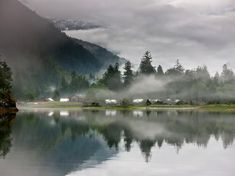 A misty morning view of Clayoquot's tents from across the Bedwell. The resort's location—between forest, river valley, and ocean—has proved popular with families.