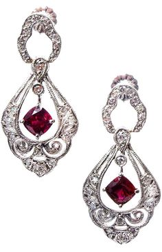 Art Deco Ruby and Diamond Platinum Dangle Earrings. Strikingly beautiful bright red Ruby early 1900's Art Deco dangle earrings. Rare bright red color certified as simple heat only no other enhancements.