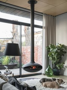 As seen on The Block. This is the only suspended fireplace made in Australia. Designed to be the focal point of your living area and built to last. It's easy to install and cooks a mean Pizza or Roast too! Distressed Fireplace, Wood Burner Fireplace, Brick Fireplace Makeover, Shiplap Fireplace, Farmhouse Fireplace, Fireplace Remodel, Fireplace Hearth, Fireplace Design, Suspended Fireplace