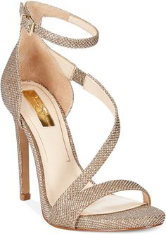 The Rayli sandals by Jessica Simpson will complete your night with dressed-up elegance. Imported Mesh fabric upper Round open-toe sandals with asymmetrical detail Ankle strap with buckle closure 1/4″ sliver platform, 4″ heel Man-made sole