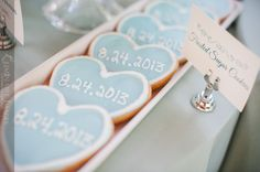 Frosted sugar cookies with the wedding date on them for dessert at a bridal shower