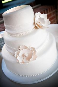 The ribbon looks so real and delicate.  Amazing White Cakes Wedding Cakes Photos on WeddingWire