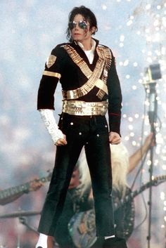 """The late King of Pop's performance is still one of the most memorable Super Bowl halftime shows ever; we loved his signature wave noveau hair and black hat for his performance of """"Billy Jean. Jackson Music, Janet Jackson, Super Bowl, Michael Wendler, The Jacksons, We Are The World, Freddie Mercury, Cool Costumes, Dance Costumes"""