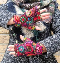Aren't these free form crochet fingerless gloves are made from 26 different colours of yarn! The yarns used are alpaca, wool, mohair, silk, linen and cotton. These were designed and made by Nana Guina. Nana has a Facebook page at https://www.facebook.com/photo.php?fbid=10207065181000797&set=a.1315827528626.47483.1018837391&type=3&theater 15740835_914462962022575_3573299682126059343_n.jpg (921×960)