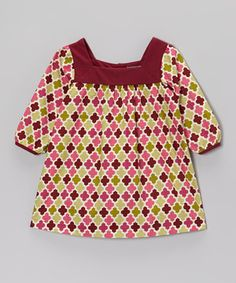 The pretty geometric print on this charming tunic is sure to turn heads. Comfy cotton construction, a wide neckline and an easy slip-over style make this piece a must for little ones who love to look good on the go.