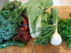 June 25, 2014: curly kale, a cucumber, beets with tops, Napa cabbage, garlic scapes, oregano, a young (uncured) onion, and curly parsley. A much smaller haul than we were expecting, but sometimes things change between the weekly Email and the pickup. This is my first pickup this summer without lettuce--I'm surprised that I'm sorry to see it go--but I'm happy to see the cabbage. It makes great kimchi.