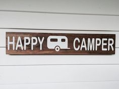 Happy Camper, stained and painted wood sign with camping trailer.  Can be customized with a tent, motorhome, pop up camper,or pick up camper