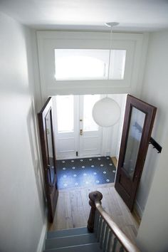 The Architect Is In: Elizabeth Roberts Adds Value in Brooklyn - Remodelista - Elizabeth Roberts, entry hall of Fort Greene townhouse, blue and white tile, Remodelista - Front Door Entrance, Door Entryway, Entry Hallway, Entryway Ideas, Entry Tile, Elizabeth Roberts, Classic Doors, Small Entryways, Duplex