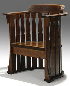 CHARLES ROHLFS; carved barrel chair, 1902; Carved R and date; 35'' x 29 3/4'' x 25''