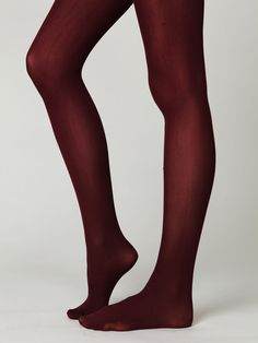 burgundy colored tights / free people