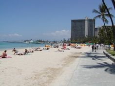 Fort DeRussy Beach, Waikiki, Hi.  The best family beach in Waikiki.  No waves. Not crowded and a beautiful grassy, shaded park behind.