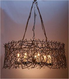 metalwork branches hanging light--i wonder if real branches and twinkle lights would work?