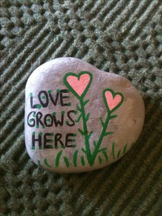 Love grows here painted rock flower heart