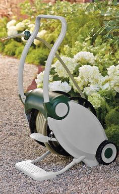 Simply pump the foot pedal of this ingenious hose reel and it automatically retracts 100 ft. of garden hose without cranking or bending over.