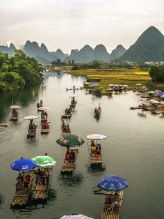 The Li River, also known as Lijiang River, is in the Guangxi region in the People's Republic of China. It's karst mountain landscape juts out of the water in all directions. I've never seen anything like this in my life.