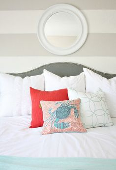 Grand Giveaway: Bedroom Makeover Reveal. The crisp white bedding, throw pillows, mint blanket and mirror make this bedroom extra relaxing. There is something so fresh and wonderful about beautiful white bedding. #sponsored #happybydesign #homegoodshappy