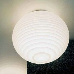 Flow Ceiling Light by rotaliana. $562.50. Design by Donegani and Lauda, 2005.Imported from Italy by Rotaliana.Spheroidal diffuser made of translucent polycarbonate. The volume of the diffuser is visually decomposed into a series of overlapping concentric rings, which intercept and propagate the light. Ceiling lights are available in 2 sizes.