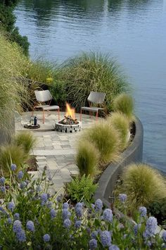 Lakeside planting and seating area with fire pit