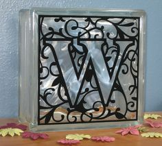 DIY vinyl monogram on glass block .... cool with lights behind it!