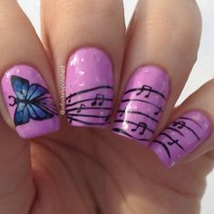 Butterfly with musical notes nail art.  The butterfly can be seen flying through the nails and leaving a musical trail. The purple and blue combination are simply perfect to highlight both the background and the butterfly designs.