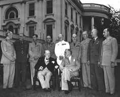 """The president and prime minister with their Combined Chiefs of Staff at the White House on May 24, 1943, the last day of the TRIDENT conference. Standing from left to right: Field Marshal Sir John Dill, the senior British officer stationed in Washington; Lieutenant General Sir Hastings L. """"Pug"""" Ismay, chief of staff to Churchill; Air Chief Marshal Sir Charles F.A. Portal, chief of the British air staff; General Sir Alan Brooke, chief of the Imperial General Staff; Admiral Sir Dudley Pound..."""