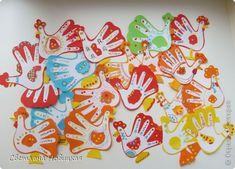 "Дымковские игрушки - петушки, курочки и индюки.  Аппликация из ""ладошек"" + декоративная роспись и аппликация.                                                                                                      Выполнили дети 5-6 лет. На 1 фото - образец педагога.  фото 13"
