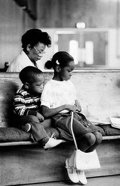 Gordon Parks-I like this photo because the emphasis is there but subjects are not dead in center. The black and white adds contrasts and the subjects face express an emotion that gives you the overall tone