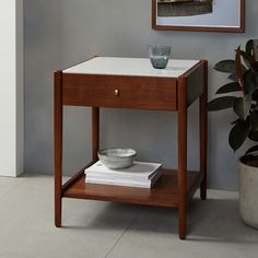 "Overall product dimensions: 20""sq. x 23""h  Robbins Mid-Century Storage Side Table 