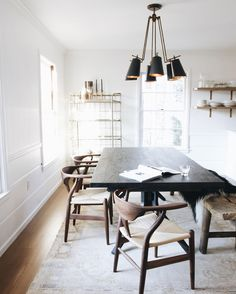 I love this chandelier, especially in contrast to the white walls!