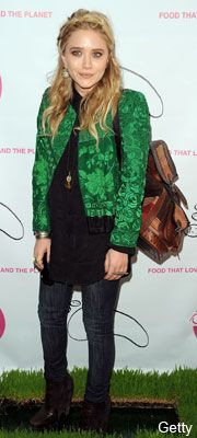 Mary-Kate Olsen in a cropped green jacket and jeans at a restaurant opening in New York