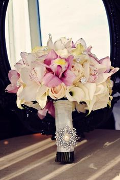 Beautiful bouquet with callas, orchids and roses embellished with a little bling...