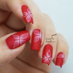Matte saturated red with soft white flowers.