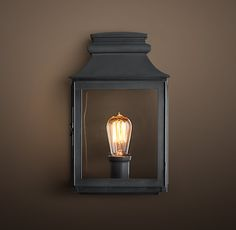 RH's Vintage French Gas Lantern Sconce:Echoing the stately lines of an antique French gas lantern, this fixture handsomely showcases the warmth of an Edison-style filament bulb.