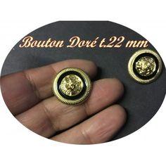 bouton a coudre en doré intérieur noir