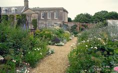 I like the creamy gravel paths in the vegetable and flower garden.....