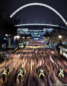 Wembley Way - 80,000 football fans streaming out of Wembley stadium towards the underground station after the England v Holland game.