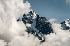Rocky summit from Mont Blanc massif briefly comes out of the clouds. Winter Mountain, Mountain Landscape, Alps, Mount Everest, Clouds, Mountains, Nature, How To Make, Travel