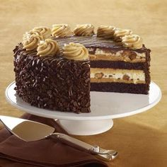 This is VERY similar to the Reese's Peanut Butter Chocolate Cake Cheesecake from Cheesecake Factory . They are over $50 from the Cheesecake...