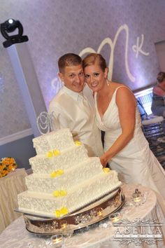 Bride and groom with their cake