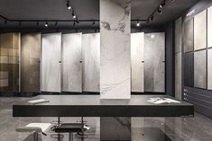 The new Ariostea Napoli showroom is located in Agnano, very close to Naples, in an extremely productive and lively area. Showroom Interior Design, Tile Showroom, Showroom Ideas, Bookstore Design, Stone Store, Retail Architecture, Stand Design, Bathroom Showrooms, Stone Gallery