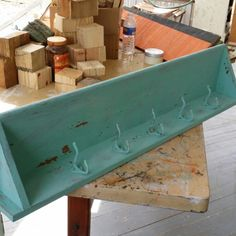 Working on this home made shelf that I painted with Sweet Pickins Milk Paint color called Patina.