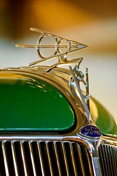 1936 Ford V8 Deluxe Roadster Hood Ornament by Jill Reger. Love the geometric design of this one.