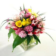 "Mixed Flower Bouquet ~ A fresh mix of spring flowers can say ""Happy Valentine's Day"" just as well as the standard dozen roses. Look for the freshest blooms and have them arranged simply in a clear square vase."