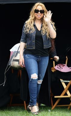 """Flaunting gorgeous curled tresses and oversized butterfly shades, Mariah Carey made her director debut for the film """"A Christmas Melody."""" Way to go, gal!"""