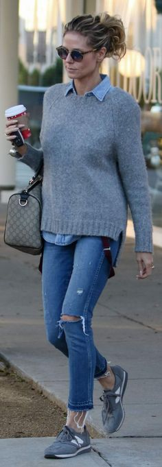 Who made  Heidi Klum's brown handbag, gray sneakers, and ripped blue jeans?