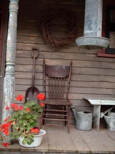 country porch, old chair, watering can, and red flowers. Country Porches, Rustic Porches, Country Life, Country Decor, Country Living, Prim Decor, Decks And Porches, Front Porches, Old Chairs