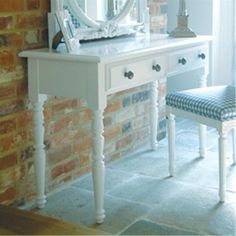 Classic Jemima White Dressing Table against an exposed brick wall.