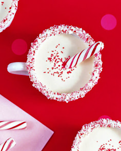 PEPPERMINT EGGNOG~ Serve eggnog, jazzed up with peppermint extract, in candy-rimmed mugs.