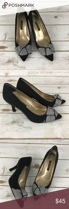 """Caparros Heels These heels have a white and black bow with an approx. heel height if 3"""". In great condition with scuff marks in the sole only.   Measurements & Information   Heel height approx 3"""" Leather sole Caparros Shoes Heels"""
